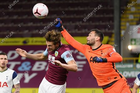 Chris Wood of Burnley (L) in action against Hugo Lloris of Tottenham (R) during the English Premier League match between Burnley and Tottenham Hotspur in Burnley, Britain, 26 October 2020.