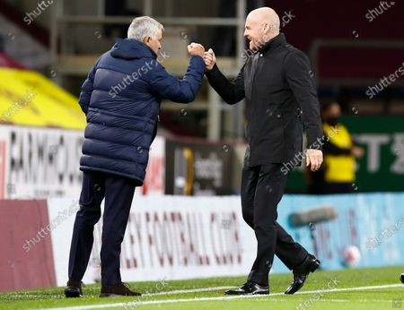 Tottenham's manager Jose Mourinho, left, and Burnley's manager Sean Dyche gesture to each other ahead of the English Premier League soccer match between Burnley and Tottenham Hotspur at Turf Moor stadium Burnley, England