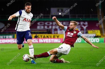 Tottenham's Matt Doherty, left, is tackled by Burnley's Charlie Taylor during the English Premier League soccer match between Burnley and Tottenham Hotspur at Turf Moor stadium Burnley, England