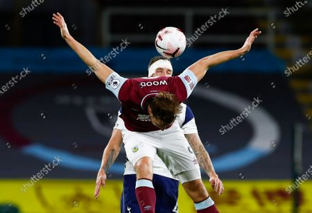 Burnley's Chris Wood is airborne as he battles for the ball with Tottenham's Toby Alderweireld during the English Premier League soccer match between Burnley and Tottenham Hotspur at Turf Moor stadium Burnley, England