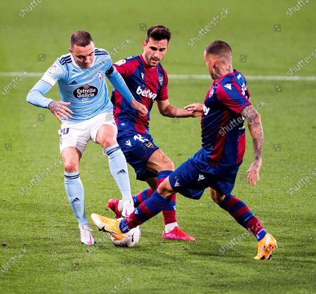 Levate UD's defender Sergio Postigo (C) in action against Celta Vigo's striker Iago Aspas (L) during the Spanish La Liga soccer match between Levante UD and Celta Vigo at La Ceramica Stadium, in Castellon, Spain, 26 October 2020.