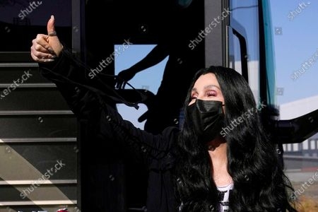 Iconic singer Cher gives a thumbs up to supporters as she arrives to speak near a polling station as she campaigns for Democratic presidential candidate Joe Biden, in Phoenix