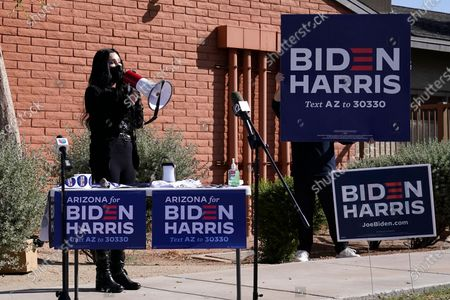 Iconic singer Cher speaks near a polling station as she campaigns for Democratic presidential candidate Joe Biden, in Phoenix