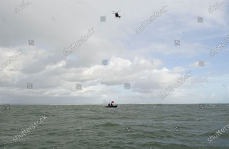 """A daredevil former paratrooper today set a world record after he jumped 131ft into the sea from a helicopter without a parachute.  John Bream, who is nicknamed 'John the Flying Fish', plummeted into the sea feet-first at 75mph as part of his daring stunt.  The 34 year old, who fell for around four seconds before hitting the water, has set two records as a result of his dive, which he took on to raise awareness for veteran suicide.  Mr Bream set a world record for the highest freefall into water from an aircraft and the record for jumping into British waters following today's leap into the Solent off Hayling Island, Hants.  The dangerous stunt could have resulted in severe injury or even death, as Mr Bream explained if the technique is wrong 'the water can absolutely rip you in half'.  Mr Bream said it felt 'amazing' to complete following a year and a half of training and the father of three said his kids have told him he is the talk of their school and that they call him the 'modern day Evel Knievel'.  Mr Bream, from Bedhampton, Hants, said: """"It feels so amazing to have finally done it, I'm so happy.  He said the previous record for diving into British waters was 122ft and the 40ft record for freefalling into water from an aircraft was held by SAS Who Dares Wins star Ant Middleton.  Mr Bream now hopes to replicate the stunt but from 200ft to beat the current 192ft world record for freefalling into water.  Mr Bream was in high spirits after the jump but taken to hospital to be checked over by medics as a precaution.  Paramedics on the shore assessed him and believe he might have suffered a slight concussion as he had complained about his neck being sore and, although he conscious throughout, he had said he couldn't remember being pulled from the water into the boat."""