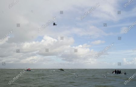 """Stock Picture of A daredevil former paratrooper today set a world record after he jumped 131ft into the sea from a helicopter without a parachute.  John Bream, who is nicknamed 'John the Flying Fish', plummeted into the sea feet-first at 75mph as part of his daring stunt.  The 34 year old, who fell for around four seconds before hitting the water, has set two records as a result of his dive, which he took on to raise awareness for veteran suicide.  Mr Bream set a world record for the highest freefall into water from an aircraft and the record for jumping into British waters following today's leap into the Solent off Hayling Island, Hants.  The dangerous stunt could have resulted in severe injury or even death, as Mr Bream explained if the technique is wrong 'the water can absolutely rip you in half'.  Mr Bream said it felt 'amazing' to complete following a year and a half of training and the father of three said his kids have told him he is the talk of their school and that they call him the 'modern day Evel Knievel'.  Mr Bream, from Bedhampton, Hants, said: """"It feels so amazing to have finally done it, I'm so happy.  He said the previous record for diving into British waters was 122ft and the 40ft record for freefalling into water from an aircraft was held by SAS Who Dares Wins star Ant Middleton.  Mr Bream now hopes to replicate the stunt but from 200ft to beat the current 192ft world record for freefalling into water.  Mr Bream was in high spirits after the jump but taken to hospital to be checked over by medics as a precaution.  Paramedics on the shore assessed him and believe he might have suffered a slight concussion as he had complained about his neck being sore and, although he conscious throughout, he had said he couldn't remember being pulled from the water into the boat."""