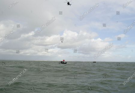 """Stock Photo of A daredevil former paratrooper today set a world record after he jumped 131ft into the sea from a helicopter without a parachute.  John Bream, who is nicknamed 'John the Flying Fish', plummeted into the sea feet-first at 75mph as part of his daring stunt.  The 34 year old, who fell for around four seconds before hitting the water, has set two records as a result of his dive, which he took on to raise awareness for veteran suicide.  Mr Bream set a world record for the highest freefall into water from an aircraft and the record for jumping into British waters following today's leap into the Solent off Hayling Island, Hants.  The dangerous stunt could have resulted in severe injury or even death, as Mr Bream explained if the technique is wrong 'the water can absolutely rip you in half'.  Mr Bream said it felt 'amazing' to complete following a year and a half of training and the father of three said his kids have told him he is the talk of their school and that they call him the 'modern day Evel Knievel'.  Mr Bream, from Bedhampton, Hants, said: """"It feels so amazing to have finally done it, I'm so happy.  He said the previous record for diving into British waters was 122ft and the 40ft record for freefalling into water from an aircraft was held by SAS Who Dares Wins star Ant Middleton.  Mr Bream now hopes to replicate the stunt but from 200ft to beat the current 192ft world record for freefalling into water.  Mr Bream was in high spirits after the jump but taken to hospital to be checked over by medics as a precaution.  Paramedics on the shore assessed him and believe he might have suffered a slight concussion as he had complained about his neck being sore and, although he conscious throughout, he had said he couldn't remember being pulled from the water into the boat."""