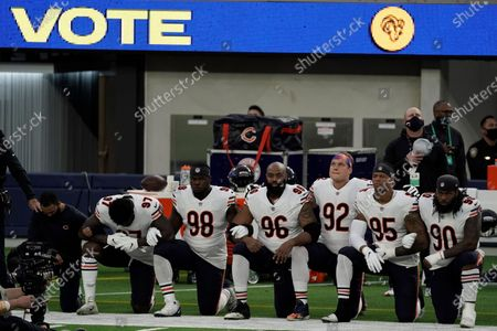 Members of the Chicago Bears kneel during the national anthem before an NFL football game against the Los Angeles Rams, in Inglewood, Calif