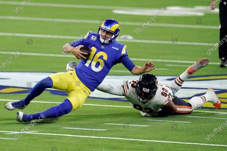 Los Angeles Rams quarterback Jared Goff (16) slides in front of Chicago Bears linebacker James Vaughters (93) during the second half of an NFL football game, in Inglewood, Calif