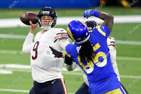Chicago Bears quarterback Nick Foles (9) throws against the Los Angeles Rams during the first half of an NFL football game, in Inglewood, Calif