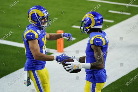 Los Angeles Rams wide receiver Josh Reynolds, right, celebrates his touchdown catch with Cooper Kupp during the first half of an NFL football game against the Chicago Bears, in Inglewood, Calif