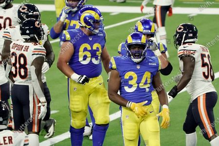 Los Angeles Rams' Malcolm Brown (34) celebrates after scoring a touchdown during the second half of an NFL football game against the Chicago Bears, in Inglewood, Calif