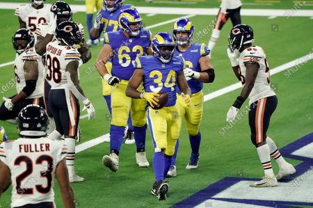 Los Angeles Rams' Malcolm Brown (34) scores a touchdown during the second half of an NFL football game against the Chicago Bears, in Inglewood, Calif