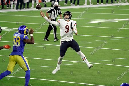 Chicago Bears quarterback Nick Foles (9) throws an interception in the end zone during the second half of an NFL football game against the Los Angeles Rams, in Inglewood, Calif