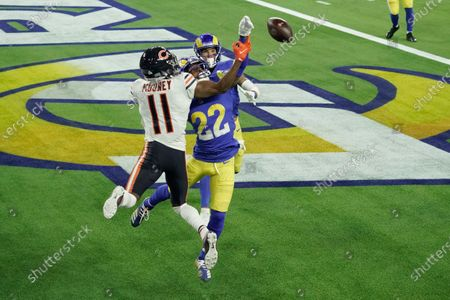 Los Angeles Rams cornerback Troy Hill (22) tips a pass in the end zone intended for Chicago Bears wide receiver Darnell Mooney (11) during the second half of an NFL football game, in Inglewood, Calif. The ball was caught by Rams safety Taylor Rapp, behind, for a touchback