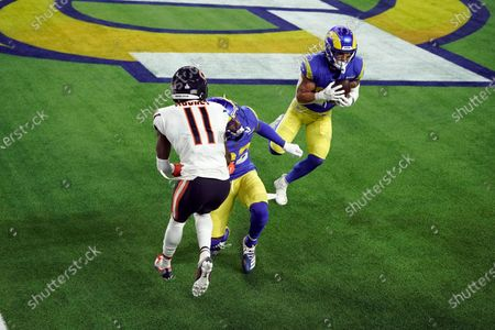 Los Angeles Rams safety Taylor Rapp, right, intercepts a tipped pass intended for Chicago Bears wide receiver Darnell Mooney (11) during the second half of an NFL football game, in Inglewood, Calif