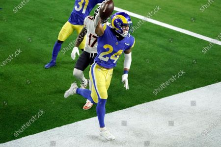 Los Angeles Rams safety Taylor Rapp (24) celebrates after intercepting a pass in the end zone during the second half of an NFL football game against the Chicago Bears, in Inglewood, Calif