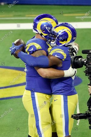 Los Angeles Rams tight end Gerald Everett, right, is hugged by a teammate after a touchdown reception against the Chicago Bears during the second half of an NFL football game, in Inglewood, Calif