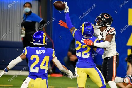 Los Angeles Rams cornerback Troy Hill (22) tips a pass in the end zone intended for Chicago Bears wide receiver Darnell Mooney, right, during the second half of an NFL football game, in Inglewood, Calif. The tipped pass was intercepted by Rams safety Taylor Rapp (24) for a touchback