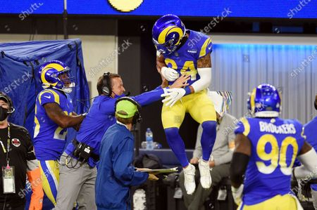 Los Angeles Rams safety Taylor Rapp, center, celebrates with coaches and teammates after intercepting a pass in the end zone during the second half of an NFL football game against the Chicago Bears, in Inglewood, Calif