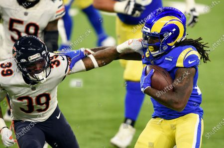 Los Angeles Rams running back Darrell Henderson, right, tries to get around Chicago Bears defensive back Eddie Jackson (39) during the second half of an NFL football game, in Inglewood, Calif