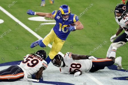 Los Angeles Rams wide receiver Cooper Kupp, top, leaps over Chicago Bears inside linebacker Danny Trevathan (59) and inside linebacker Roquan Smith (58) during the second half of an NFL football game, in Inglewood, Calif