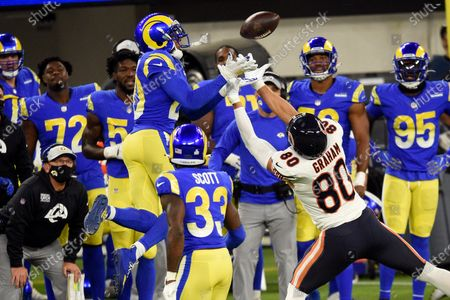 Los Angeles Rams cornerback Jalen Ramsey, left, intercepts a pass intended for Chicago Bears tight end Jimmy Graham (80) during the second half of an NFL football game, in Inglewood, Calif