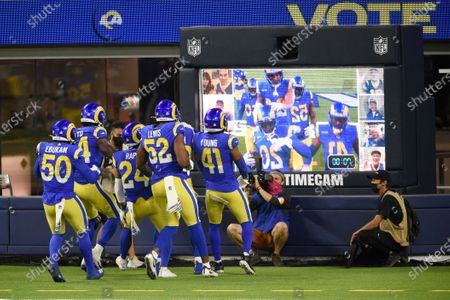 Los Angeles Rams players celebrate after an interception by Jalen Ramsey during the second half of an NFL football game against the Chicago Bears, in Inglewood, Calif