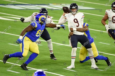 Chicago Bears quarterback Nick Foles (9) is sacked by Los Angeles Rams linebacker Justin Hollins during the second half of an NFL football game, in Inglewood, Calif
