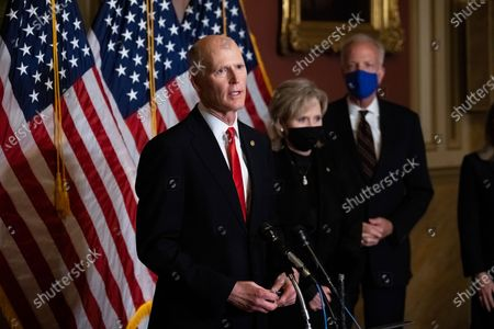 Sen. Rick Scott, R-Fla., speaks during a news conference after the Senate voted to confirm Amy Coney Barrett to the Supreme Court, in Washington. Barrett was confirmed by the Senate as the 115th justice to the Supreme Court