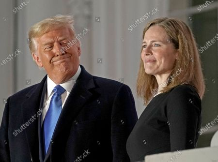 United States President Donald J. Trump and Justice Amy Coney Barrett pose for a photo on the Blue Room Balcony of the White House in Washington, DC, US, Editors' Picks