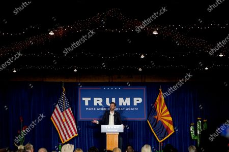 Eric Trump, son of President Donald Trump, speaks with supporters at a campaign rally, in Phoenix