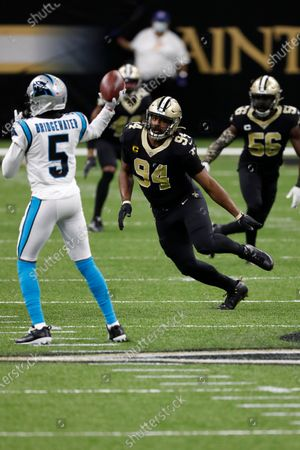New Orleans Saints defensive end Cameron Jordan (94) and Carolina Panthers quarterback Teddy Bridgewater (5) during an NFL football game, in New Orleans