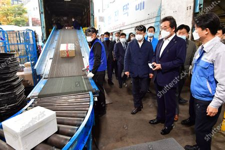 Lee Nak-yon (2-R), head of the ruling Democratic Party, inspects a Hanjin Transportation Co. delivery center in Seoul, South Korea, 27 October 2020, to check the working conditions of deliverymen. The inspection followed the recent death of a Hanjin deliveryman due apparently to overwork from a surge in demand for deliveries amid the COVID-19 pandemic.