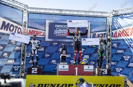 Monterey, CA, U.S.A. Travis Wyman, Cameron Petersen and Corey Alexander show off there MotoAmerica check on the podium after the Geico Motorcycle MotoAmerica Superbike Speedfest Superbike Championship at Weathertech Laguna Seca Monterey, CA Thurman James / CSM