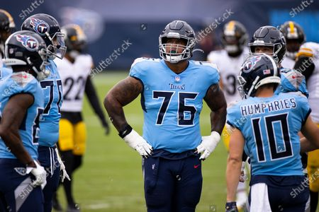 Tennessee Titans offensive guard Rodger Saffold (76) pauses between plays against the Pittsburgh Steelers during the first half of an NFL football game, in Nashville, Tenn