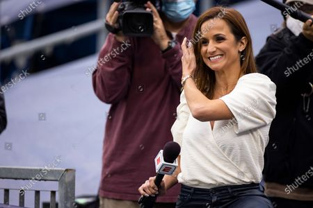 Reporter Dianna Russini watches warm ups before an NFL football game between the Tennessee Titans and the Pittsburgh Steelers, in Nashville, Tenn
