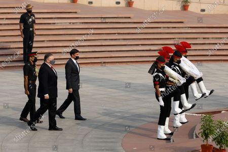 Secretary of State Mike Pompeo and Secretary of Defence Mark Esper arrive to pay their tributes at the National War Memorial in New Delhi, India, . In talks on Tuesday with their Indian counterparts, Pompeo and Esper are to sign an agreement expanding military satellite information sharing and highlight strategic cooperation between Washington and New Delhi with an eye toward countering China