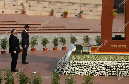 Secretary of State Mike Pompeo, foreground, and Secretary of Defence Mark Esper pay their tributes at the National War Memorial in New Delhi, India, . In talks on Tuesday with their Indian counterparts, Pompeo and Esper are to sign an agreement expanding military satellite information sharing and highlight strategic cooperation between Washington and New Delhi with an eye toward countering China