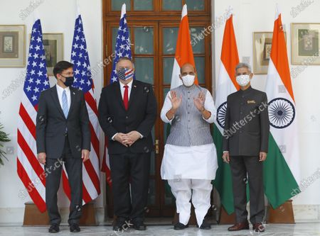 Secretary of State Mike Pompeo, second left, and Secretary of Defence Mark Esper, left, stand for photographs with Indian Foreign Minister Subrahmanyam Jaishankar, right, and Defence Minister Rajnath Singh ahead of their meeting at Hyderabad House in New Delhi, India, . In talks on Tuesday with their Indian counterparts, Pompeo and Esper are to sign an agreement expanding military satellite information sharing and highlight strategic cooperation between Washington and New Delhi with an eye toward countering China