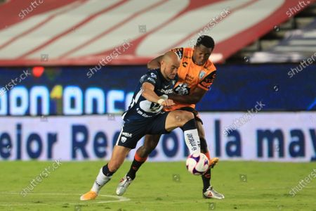 Oscar Murillo (R) of Pachuca in action against Carlos Gonzalez (L) of Pumas during a Torneo Guardianes 2020 Liga MX championship soccer match between Pachuca and Pumas UNAM at the Hidalgo Stadium in Pachuca, Mexico, 26 October 2020.