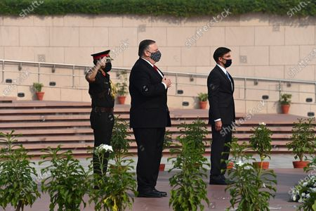Secretary of State Mike Pompeo, center, and Secretary of Defence Mark Esper pay their tributes at the National War Memorial in New Delhi, India, . In talks on Tuesday with their Indian counterparts, Pompeo and Esper are to sign an agreement expanding military satellite information sharing and highlight strategic cooperation between Washington and New Delhi with an eye toward countering China