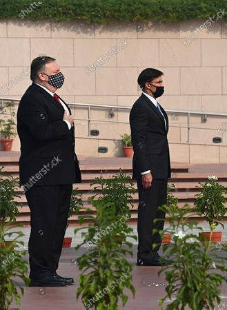 Secretary of State Mike Pompeo, left, and Secretary of Defence Mark Esper pay their tributes at the National War Memorial in New Delhi, India, . In talks on Tuesday with their Indian counterparts, Pompeo and Esper are to sign an agreement expanding military satellite information sharing and highlight strategic cooperation between Washington and New Delhi with an eye toward countering China