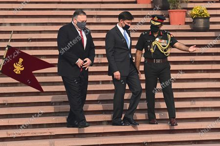 Secretary of State Mike Pompeo, left, and Secretary of Defence Mark Esper arrive to pay their tributes at the National War Memorial in New Delhi, India, . In talks on Tuesday with their Indian counterparts, Pompeo and Esper are to sign an agreement expanding military satellite information sharing and highlight strategic cooperation between Washington and New Delhi with an eye toward countering China