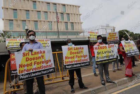 Members of People's Liberation Front, a marxist political party, protest outside the U.S. embassy in Colombo, Sri Lanka, . The protest against alleged U.S. intervention in the country's domestic matters, was held before the arrival of U.S. Secretary of State Mike Pompeo