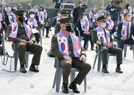 Bradley James, commander of the U.S. Marine Corps in South Korea (L) attends a ceremony for the 70th anniversary of the Korean War and the 5th Commemoration ceremony of Changjin Campaign Heroes, at the Korean War Memorial Museum in Seoul, South Korea, 27 October 2020. The ceremony was held to pay tribute to soldiers killed in the Changjin Reservoir Battle, one of the fiercest and most decisive battles during the three-year conflict. The battle in December 1950 came as US-backed South Korean forces began retreating from North Korea after China sent massive numbers of troops to fight alongside the communist neighbor.