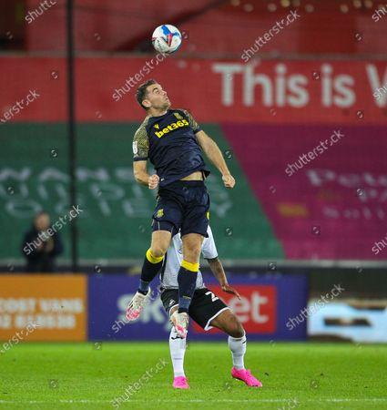 Sam Vokes of Stoke City beats Kyle Naughton of Swansea City to the high ball; Liberty Stadium, Swansea, Glamorgan, Wales; English Football League Championship Football, Swansea City versus Stoke City.