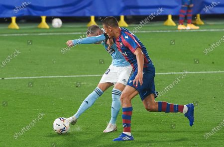 Iago Aspas of RC Celta de Vigo and Duarte of Levante during the La Liga Santander mach between Levante and Celta at Estadio de la Ceramica, on October 26, 2020 in Vila-real Spain