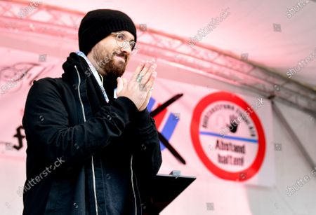 German-Russian concert pianist Igor Levit reacts after performing during a protest against the Alternative for Germany (AfD) right wing populist party in Potsdam, Germany, 27 October 2020.