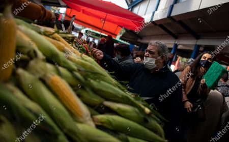 A man wearing a face mask buys vegetables at a large open market in Sofia, Bulgaria, 27 October 2020. Bulgaria continues to record almost every day a new record of COVID-19 positives over the last three weeks. The number of deaths in 24 hours reached 42. Prime Minister Boyko Borisov tested positive on 25 October and works in quarantine at home, as do seven of the 17 ministers who have been in contact with Borisov in the last few days.