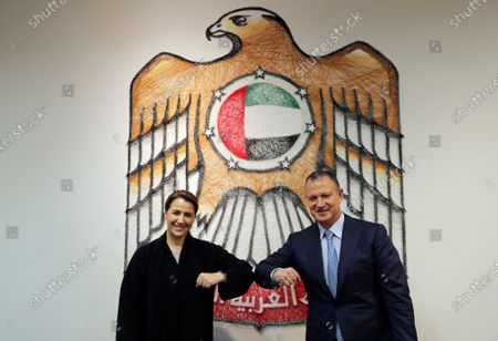 Minister of State for Food and Water Security Mariam al-Muhairi, left, and Erel Margalit, founder and chairman of Jerusalem Venture Partners, touch elbows after their meeting at the headquarter of the Government Accelerators, in Dubai, United Arab Emirates
